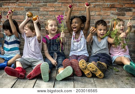 Group of Diverse Kids Sitting with Fresh Vegetable Together