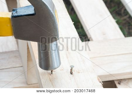 Hammer And Nail On Wood.