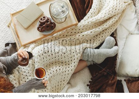 Young woman spending a cold night in bed with blanket