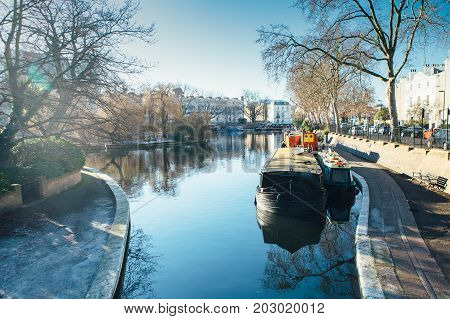 View of a houseboat in a channel at Little Venice in London