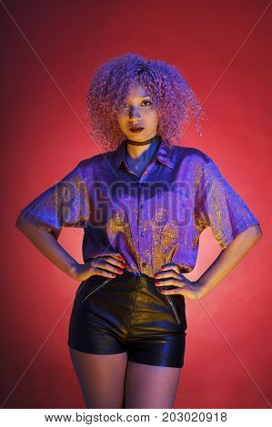 isolated black woman dressed in a groovy style from the nineteens