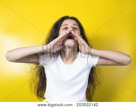 Beautiful Young Woman Holding Hand On Chin And Shouting.