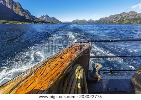 Trail  Behind Of The Ship On Water Surface On Trollfjord