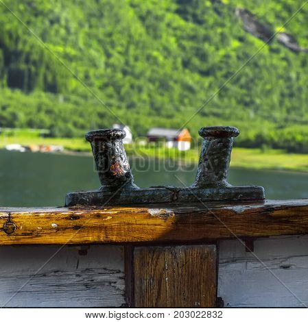 Double Bollard On The Ship Against  Of  Trollfjord  Background.