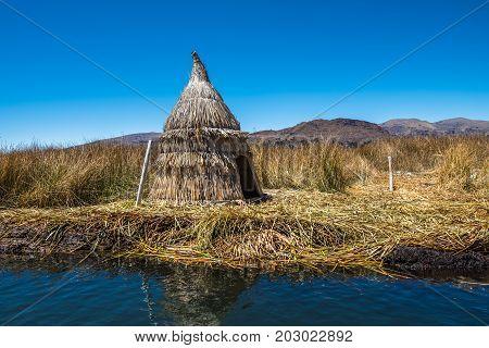 Totora reed huts on a manmade floating island Lake Titicaca Peru