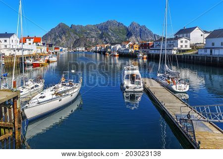 Scenic View Of The Waterfront Harbor In Henningsvaer In Summer