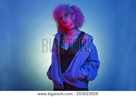 sexy woman with trendy jean clothes as a flashback from the eighties