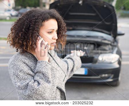 Desperate woman calling for emergency help after vehicle breakdown
