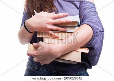 Female Student Carrying A Pile Of Books