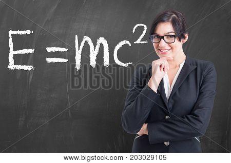 Teacher Written On The Blackboard Formula In Physics