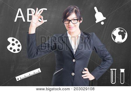 Beautiful School Professor In Front Of Blackboard