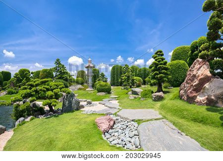 Beautiful garden in ecotourism is designed harmony with cypress, pine, stone and ancient trees bearing traditional culture of traditional Japanese gardens.
