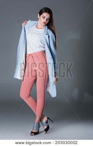 Girl In Blue Trench