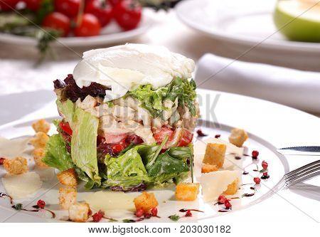 Caesar salad with chicken and mozzarella.