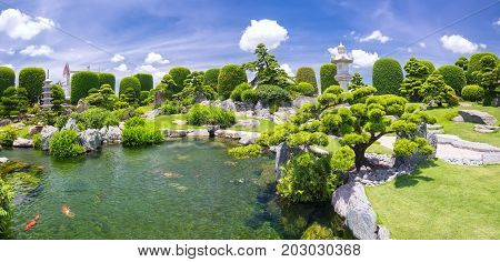 Beautiful garden in ecotourism designed in harmony with cypress, pine, stone, water and ancient trees bearing traditional culture of traditional Japanese gardens.