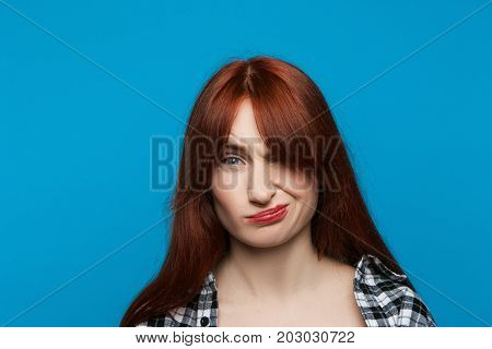 Hesitative woman portrait. Unimpressed girl. Disappointment in someone, distrustful emotion concept