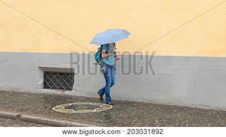 Mysterious Girl Walking With Umbrella