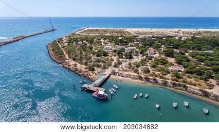 Breakwater channel in Quatro aguas, Tavira Island. View from the sky
