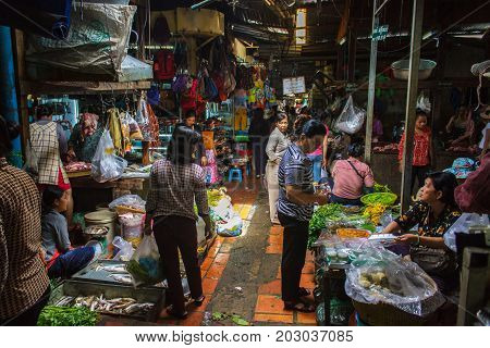 PHNOM PENH CAMBODIA - AUGUST 11 2015: Customers browse the varius stalls in the Russian market in Phnom Penh.
