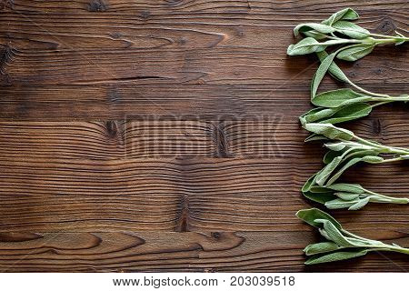 fresh herbs and greenary for spices and cooking on wooden kitchen desk background top view mock up