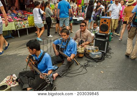 CHIANG MAI THAILAND - 6/13/2015: Musicians play for the tourists at Chiang Mai's weekly Sunday market.