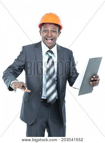 Image of happy business man in helmet which posing