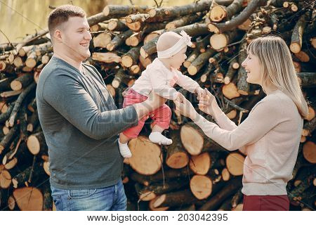 beautiful mother with husbant and little daughter in the summer park