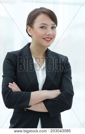 Modern pretty  business woman in a bright  office