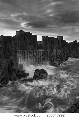 Landscape of Basalt rock formations with a view to the sea at Bombo Headland quarry New South Wales Australia