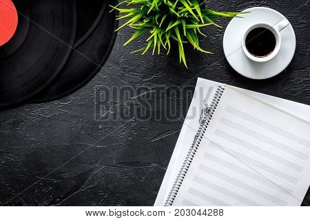 dj work set with blank paper for notes, records on dark table background top view space for text