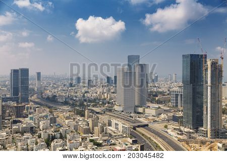 Tel Aviv Skyline at Sunny Summer Day  / Tel Aviv Cityscape In Daylight, New Skyscraper Constraction Site and Aylon Freeway.