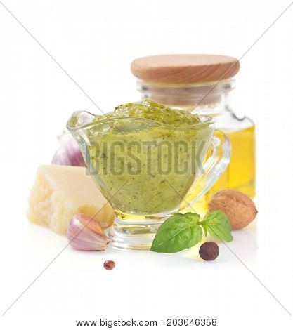 pesto sauce in gravy boat isolated on white background