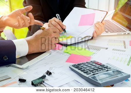 Business concept,Executives are instructing secretaries,The secretary is taking note of the executive order and on the desk there is a calculator with the document placed.