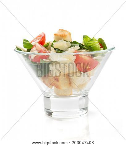 caesar salad in glass bowl isolated on white background