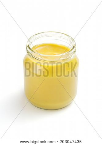 mustard sauce in jar isolated on white background