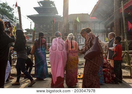 KATHMANDU NEPAL - 9/26/2015: Devotees gather at Durbar Square during the Indra Jatra festival in Kathmandu Nepal.
