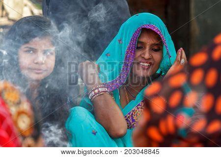 KATHMANDU NEPAL - 9/26/2015: A Hindu woman in a traditional sari at Durbar Square in Kathmandu Nepal.