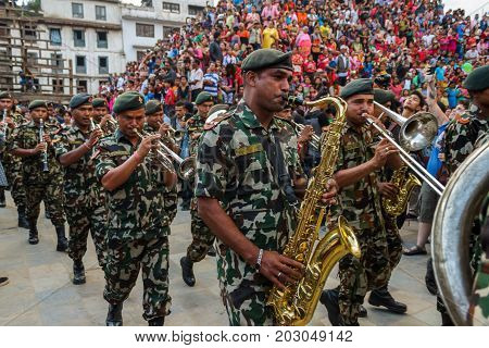 KATHMANDU NEPAL - 9/26/2015: Nepali military musicians perform during the Indra Jatra festival at Durbar Square in Kathmandu Nepal.