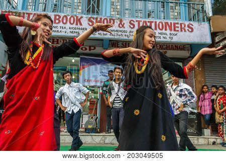 POKHARA NEPAL - 11/9/2015: A group of young Nepalese performers dance in traditional clothes during the Tihar festival in Pokhara Nepal.