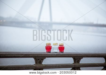 A Beautiful Red And White Candles On The Railing Of A River Side In The Foggy November Morning In Ri