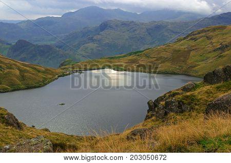 Stickle Tarn English Lake District Cumbria UK,High mountain lake district tarn,lake with distant haze covered mountain background