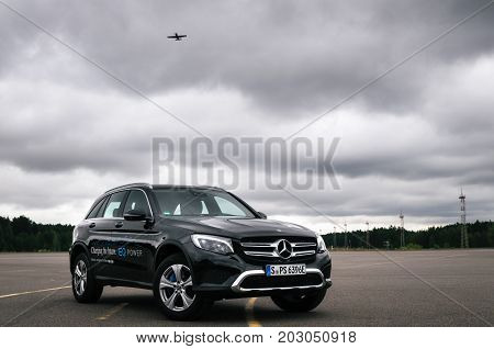 Minsk Belarus - August 26 2017: Front view of Mercedes-Benz GLC 350 e Plug-In Hybrid against the plane and sky.
