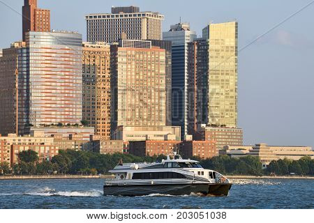 JERSEY CITY NJ - AUGUST 23: Ferry boat on The Hudson River on August 23 2017. Ferry features service that connects Manhattan with Jersey City.