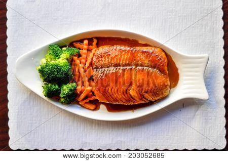 Salmon Teriyaki, Grilled salmon with teriyaki sauce, broccoli and carrot