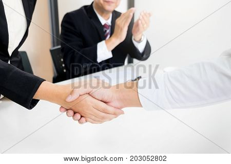 Successful Business Team Shaking Hands With Eachother In The Office, Job Interview Concept
