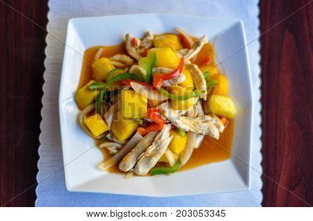 Stir-Fried Mango Chicken, Stir-fried chicken with fresh mango, bell pepper, onion in sweet and sour sauce