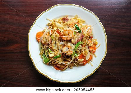 Shanghai Noodle, Stir-fried vermicelli rice noodles with egg, carrots, napa, onion, celery and bean sprout