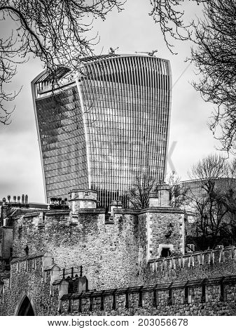 London , March 2017 United Kingdom: View of 20 Fenchurch St. building called walkie talkie and Tower of London Walls - historic castle on north bank of River Thames.