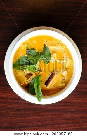 Red Curry, A delicate mix of red curry in coconut milk with eggplant, bamboo shoots, bell peppers and sweet basil leaves