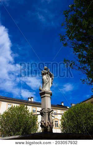 Beautiful view of old fountain in the historical part of the Austrian city Salzburg.